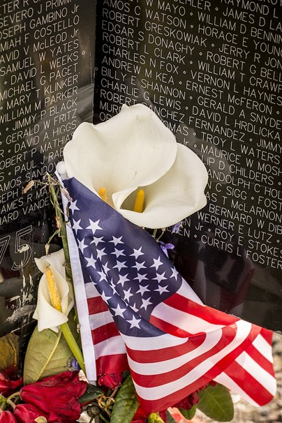 Visitors to the replica Wall left flowers, flags, mementos and memorabilia, including at least one bottle of beer. - MARK LARSON