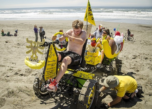 """After a pit stop in the Manila dunes, racers (like the Banana Split team shown here) travel on the ocean beach for a few miles, back through """"June's Dunes"""" and then on to Dead Man's Drop. - MARK LARSON"""