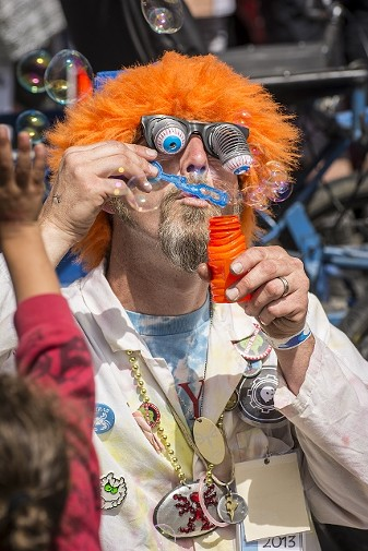 Josh Nikolauson, of McKinleyville, a member of the Kinetic Paranormal Society and follower of the Travelling Magical Wardrobe, provides bubbles and laughs in Ferndale at the Kinetic Grand Championship 2014. - MARK LARSON