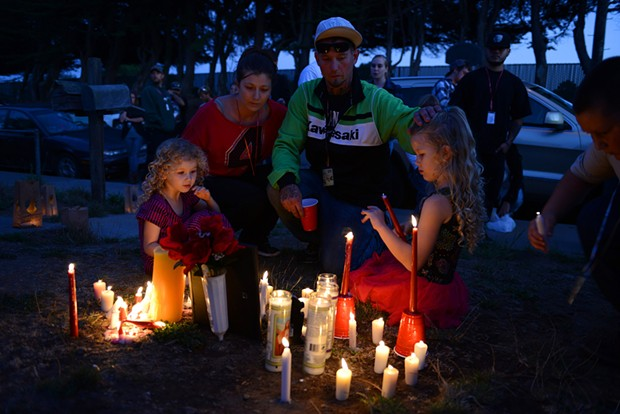 Nichole and Josh Mottern sit near a photo of McClain with their daughters Kendra, right, and Valorie. Josh Mottern was McClain's cousin and McClain had been living with the Motterns at a home on Allard Avenue in Eureka. McClain was fatally shot outside the home early Wednesday morning. - MARK MCKENNA