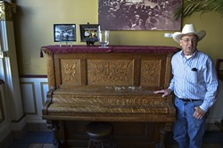 PHOTO BY GRANT SCOTT-GOFORTH - Oberon co-owner Roy Kohl won't let anyone play his upright grand piano in the Oberon Grill because of music licensing fees.