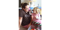 PHOTO BY CAROL HARRISON - Of the 220 licensed family child care homes in Humboldt County, 157 are family child care homes similar to the one run by Carissa Bowser-Smith, pictured here with her daughter, Kirstalyn. The rest are licensed children's centers.