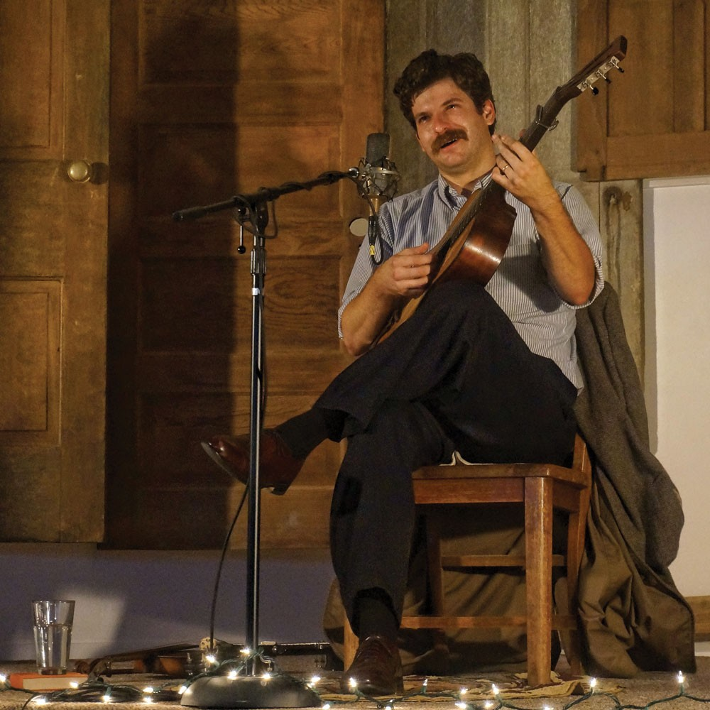 Old-time fiddler, banjo player and guitarist Frank Fairfield picks out a tune in a solo concert at The Sanctuary in Arcata on July 6. - PHOTO BY BOB DORAN