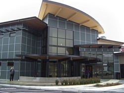 PHOTO BY HEIDI WALTERS - Open Door Community Health Centers' newest clinic, the Eureka Community Health & Wellness Center on Tydd Street, was built with a $9.8 million grant through the Affordable Care Act. Open Door CEO Herrmann Spetzler (in front) says the 27,400-foot modern, high-tech, green-design facility with six pods of health teams should attract the new kind of doctor who doesn't want to scrabble at a private practice.