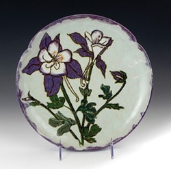 Otamay Hushing's plate full of columbines is at the Fire Arts gallery.