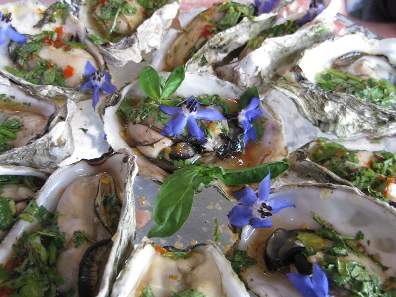 Oysters with sweet chili, fish sauce and cilantro. - JENNIFER FUMIKO CAHILL