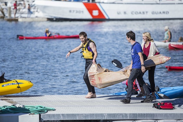 Contestants pull their cardboard boat from the water after racing in the bay at Paddlefest in Eureka Sat. Sept. 13.