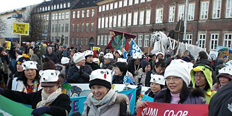 Hopenhagen Parliament Square, Copenhagen Denmark, 12/12/2009 1 PM Japanese Coop members join the March. Photo by David Simpson.