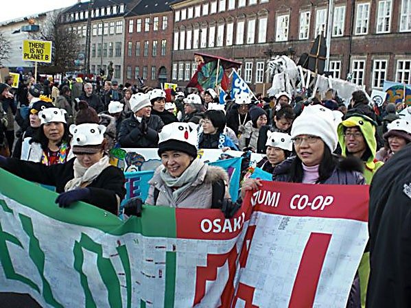 Parliament Square, Copenhagen Denmark, 12/12/2009  1 PM Japanese Coop members join the March. Photo by David Simpson.