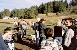 People and dogs gather to roust deer.