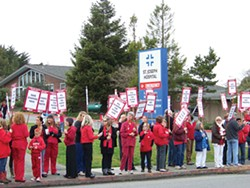 PHOTO BY HEIDI WALTERS. - Picketing outside St. Joseph Hospital in Eureka.