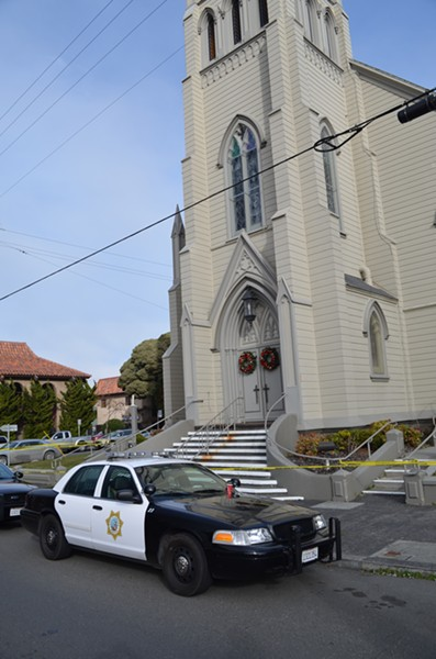 Police have roped off St. Bernard's Church and the neighboring rectory, where Pastor Eric Freed was found dead this morning. - GRANT SCOTT-GOFORTH