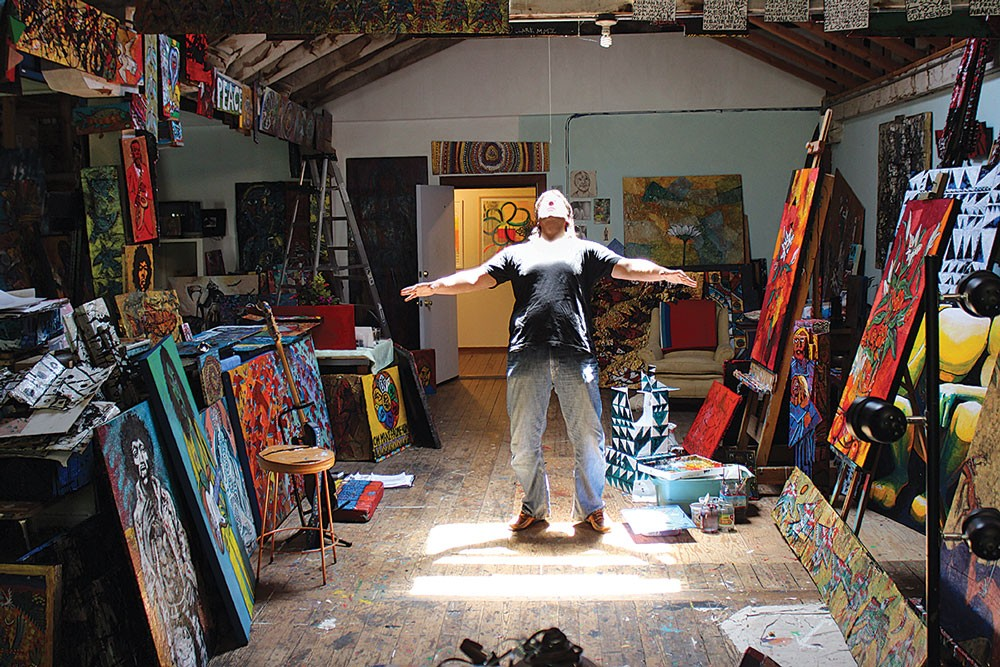 Prolific painter Augustus Clark soaks up the sun in his workspace in Eureka's C Street Studios on Sunday, June 1, day two of the countywide North Coast Open Studios, which continues this weekend. - PHOTO BY BOB DORAN