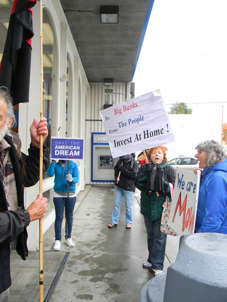 Protesters chant outside Chase in Eureka on Saturday. - PHOTO BY CARRIE PEYTON DAHLBERG