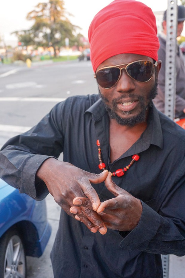 Rastafarian singer Winston van Ewijk, aka Winstrong, from Surinam, prepares for his set at Something for Everyone, C Baker's Showcase at the Jambalaya Friday night, Aug. 8. - PHOTO BY BOB DORAN