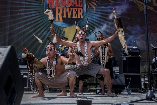 Karuk and Yurok men demonstrate a brush dance at the 30th Annual Reggae On The River 2014, Friday Aug.1. - ALEXANDER WOODARD