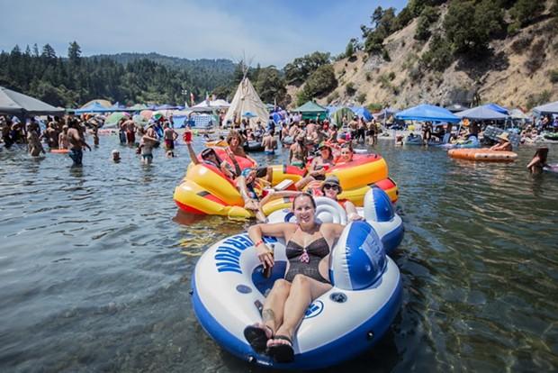 ROTR attendees keep cool in the Eel River as air temperatures reach 106 degrees. - ALEXANDER WOODARD