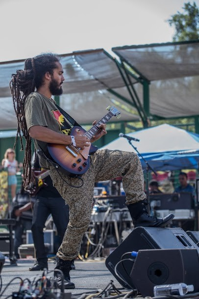 Eduardo Schach-Bonit of I-Kronik jamming out at the 30th Annual Reggae On The River 2014, Friday Aug. 1. - ALEXANDER WOODARD