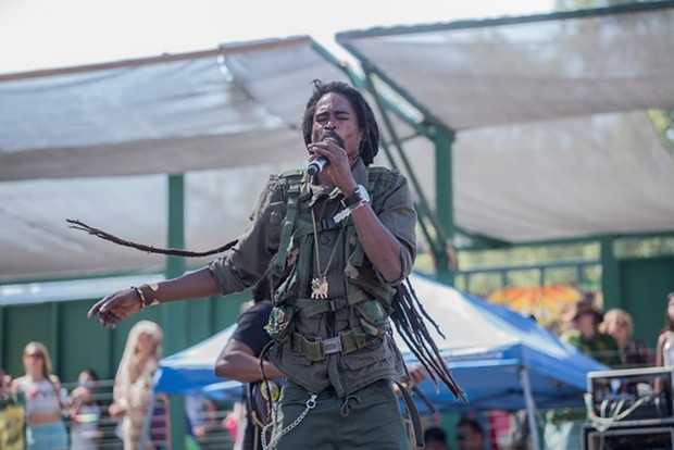 Kana Jah of I-Kronik performing at the 30th Annual Reggae On The River 2014, Friday Aug. 1. - ALEXANDER WOODARD