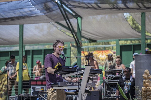 "Evan ""Evton B"" Burtan performing with Indubious at the 30th Annual Reggae On The River 2014, Saturday Aug.2."