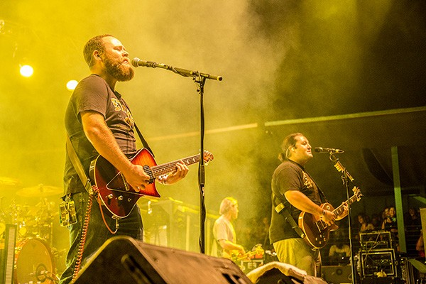 Micah Brown, left, and Micah Pueschel of Iration performing at the 30th Annual Reggae On The River 2014, Saturday Aug. 2.