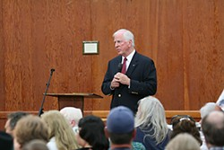 Representative Mike Thompson addresses a local crowd at Redwood Acres. Photo by Bob Doran
