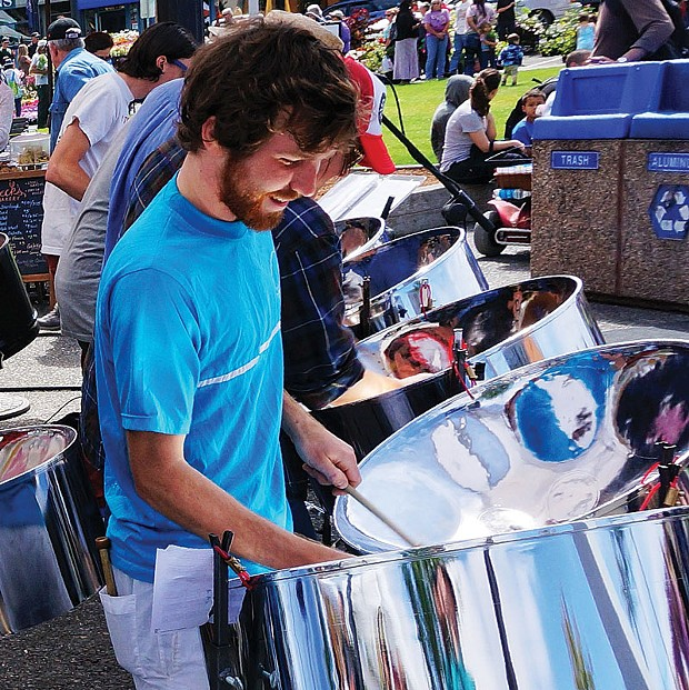 Riley Kennedy-Keys shines in the front line of the rhythmic pan band Steel Standing, providing a soundtrack for the Arcata Farmers Market Saturday, June 21. - PHOTO BY BOB DORAN