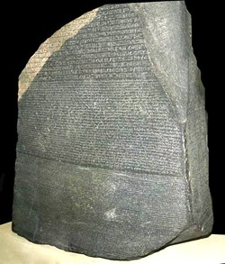 WIKIMEDIA COMMONS, HANS HILLEWAERT. - Rosetta Stone. Top, hieroglyphic script; middle, demotic; bottom, Greek.