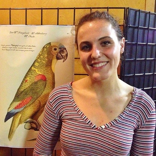 Samantha Herbert and a drawing of a parrot  by von Humboldt - BOB DORAN
