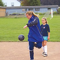 Soccer Dreams Sandrine Ringler, a Women's French Football Federation coach and former National team player, demonstrates a move while Emma Gomes of FC Samoa watches. Photo by Heidi Walters