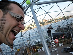 Self-portrait of HSU instructor Lonny Grafman, helping construct a geodesic dome on a barge called the Waterpod.