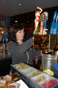 PHOTO BY ANDREW GOFF - Six Rivers Brewery co-owner Meredith Maier workin' the taps at her McKinleyville brew pub.