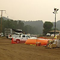 Fire Without End Smoke hangs over the base camp in Junction City. Photo By David Garrison