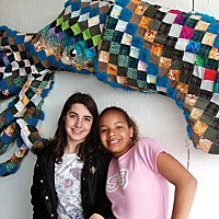 Pollution as Art Students Angel Rush and Dalia Murry from Peninsula Union School pose in front of Jimmie Nord's Squilt. Photo by Katherine Almy.