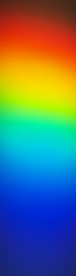 PHOTO BY BARRY EVANS. - Sun-spectrum from author's one-inch prism.
