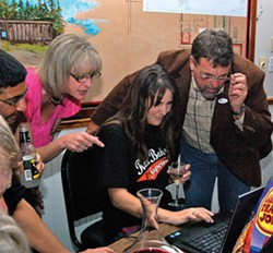 PHOTO BY ANDREW GOFF - Supervisorial candidate Rex Bohn, future colleague Supervisor Virginia Bass and supporters get their first satisfying taste of Tuesday's election results.
