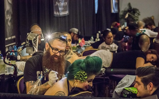 Tattoo artists and the recipients of their work crowded the booths at the Inked Hearts Tattoo Expo. - MARK LARSON
