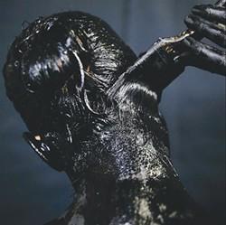 "COURTESY OF THE ARTIST - Teresa Fernandez paints it black in ""erasure."""