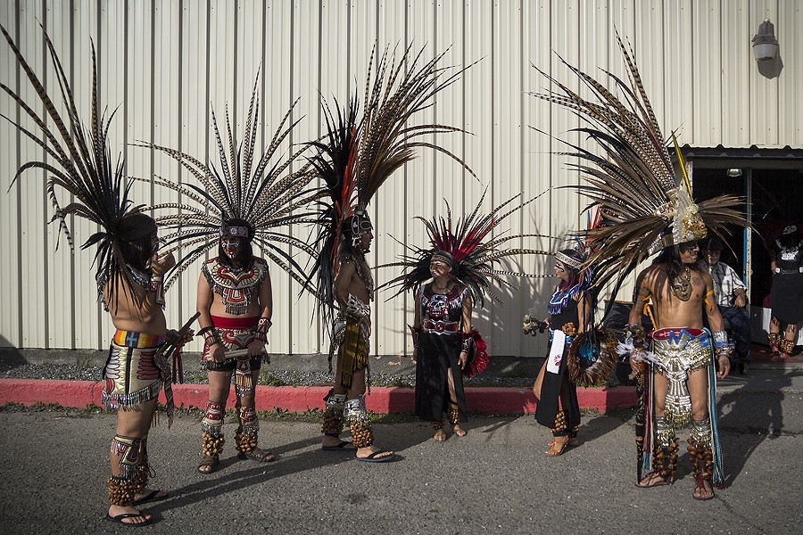 Tezkatlipoka Aztec Dance & Drum group awaits for its performance outside of Franceshi Hall. - MANUEL J. ORBEGOZO