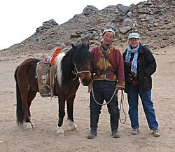 The artist with a Mongolian Herder, who wouldn't be pictured without his horse.