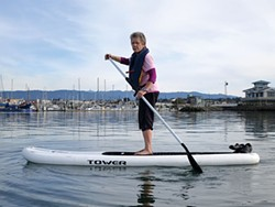 PHOTO BY BARRY EVANS - The author on her inflatable stand-up paddleboard in Humboldt Bay.
