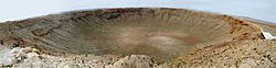 The Barringer Meteor Crater, nearly a mile across and a quarter mile deep, 40 miles east of Flagstaff, Arizona. Phot panorama by Barry Evans.