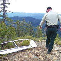 Tree Cop The control center of Six Rivers National Forest LEO Bobby Phillips' patrol vehicle includes a Garmin navigation system and a cheat sheet Phillips made for the police phonetic alphabet that the Forest Service uses. Photo by Heidi Walters