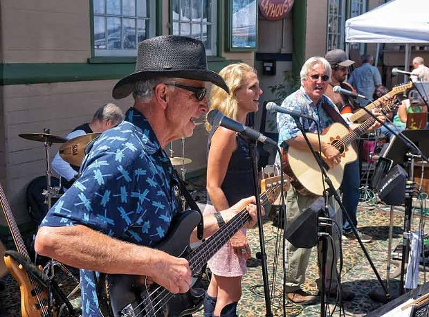 The country rock band Firesign plays in front OF the Arcata Playhouse for the monthly Creamery District Art Market on the last Saturday of the month, July 26. - PHOTO BY BOB DORAN.