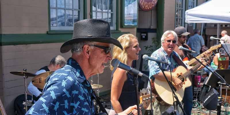 The country rock band Firesign plays in front OF the Arcata Playhouse for the monthly Creamery District Art Market on the last Saturday of the month, July 26.