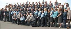 The entire police department poses for a group shot. Photo by Hank Sims.