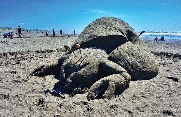 "The fanciful ""Crab Apple"" by the Monsando team earned Best of Show with an unlikely cross-species mutation and a commentary on GMOs at Friends of the Dunes' 19th annual Sand Sculpture Festival at the Manila Dunes Recreation Area on Saturday, June 21. - PHOTO BY BOB DORAN"