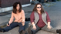 The long legs of the law: Bullock and McCarthy star in The Heat.Reviews