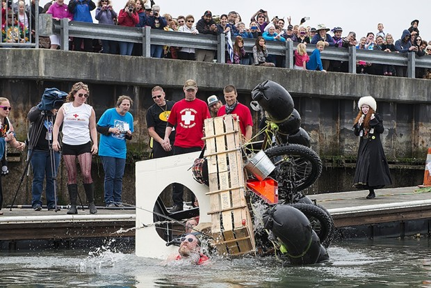 The Moonshine Banditos capsize shortly after entering Humboldt Bay during the second day of the 2015 Kinetic Grand Championship. - MARK MCKENNA
