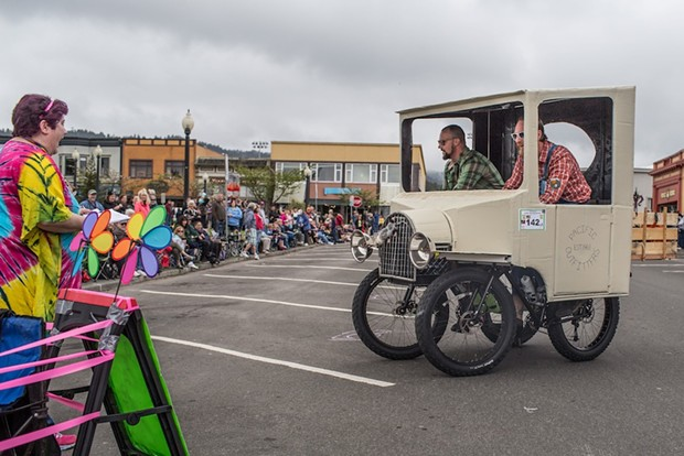 The Moonshine Banditos take their cart for a swing in front of the judges and crowd. - ALEXANDER WOODARD